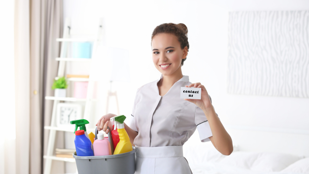 Housekeeper holding her cleaning products in a caddy
