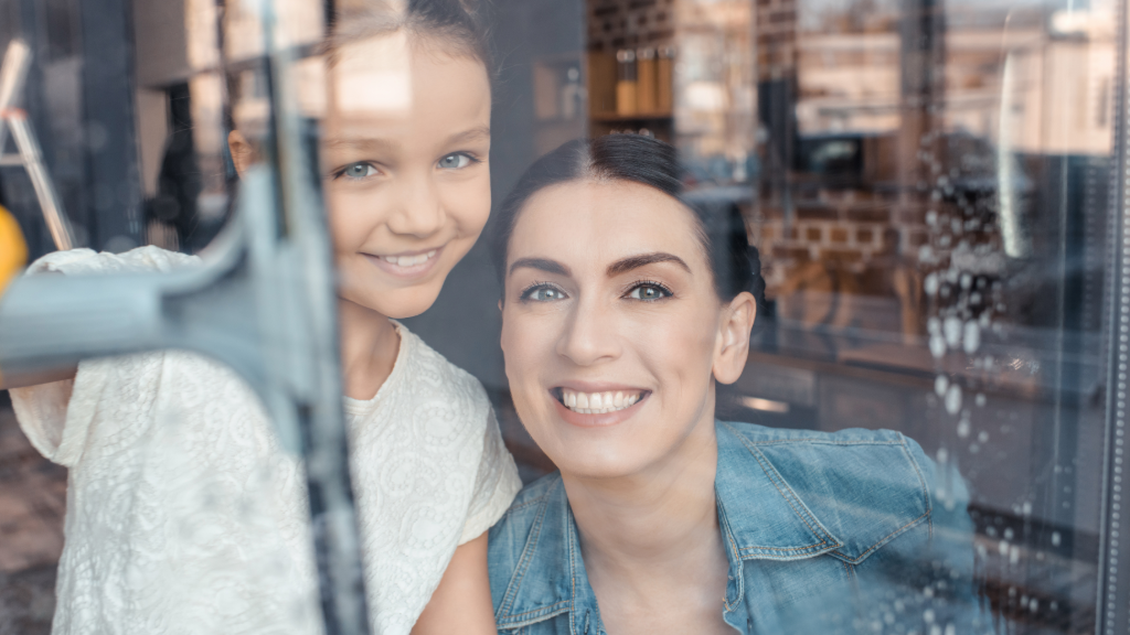 Woman and girl behind a glass window