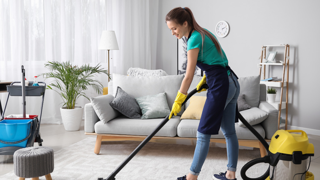 Young woman vacuuming in the living room