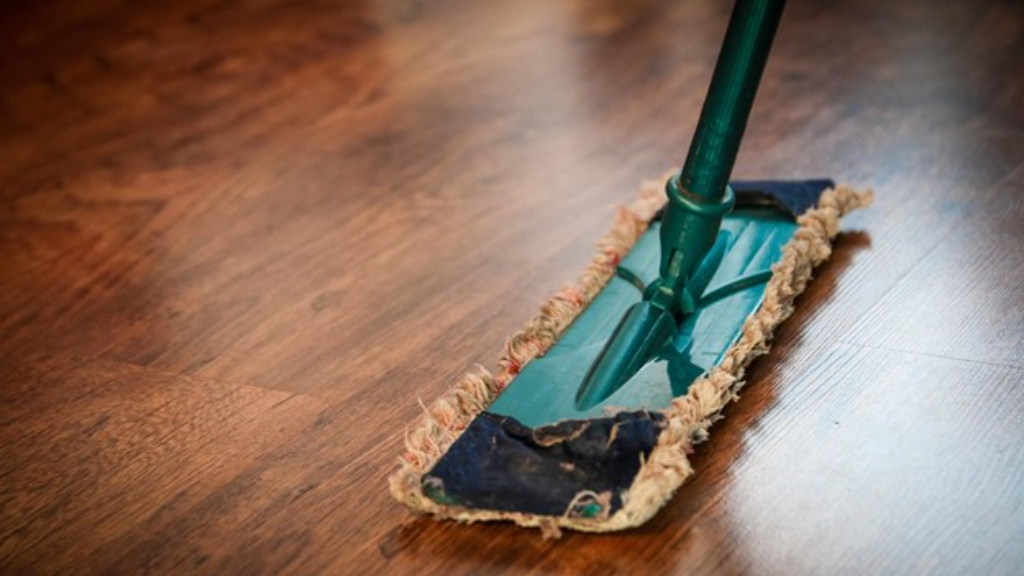 Dry mop on the wood floor.