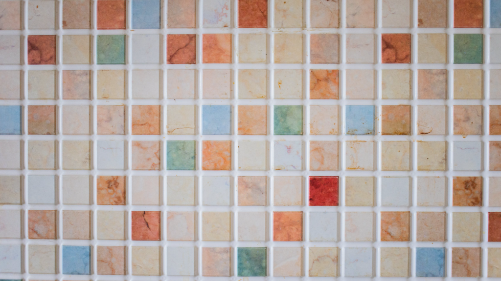 Ceramic tiles with grout after cleaning with homemade grout cleaner recipe.
