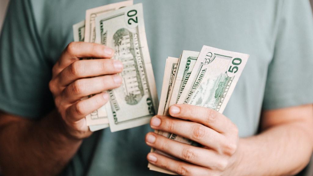 A man counting dollar bills