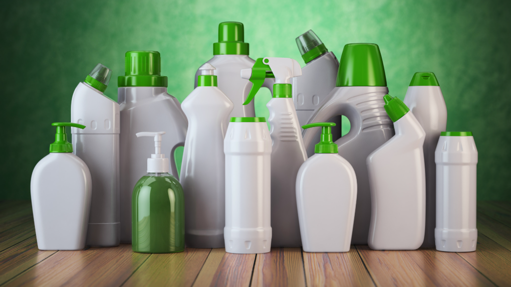 Different cleaning bottles in green and white color.